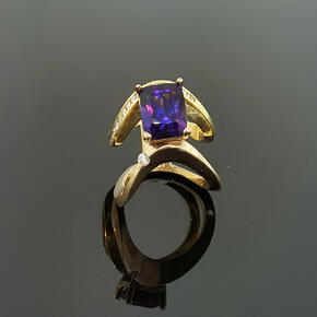 Amethyst Joining Two Gold Rings Together