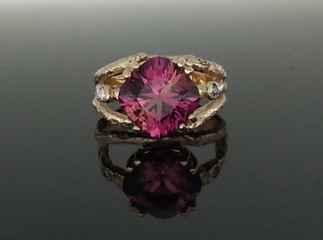 Hand-faceted tourmaline in a custom made 14K gold branch ring with two small diamonds on either side