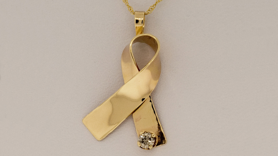 14K gold cancer awareness ribbon pendant with diamond