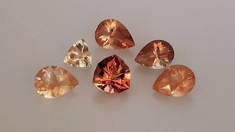 Six Loose Faceted Oregon Sunstones Ranging from Yellow to Deep Orange